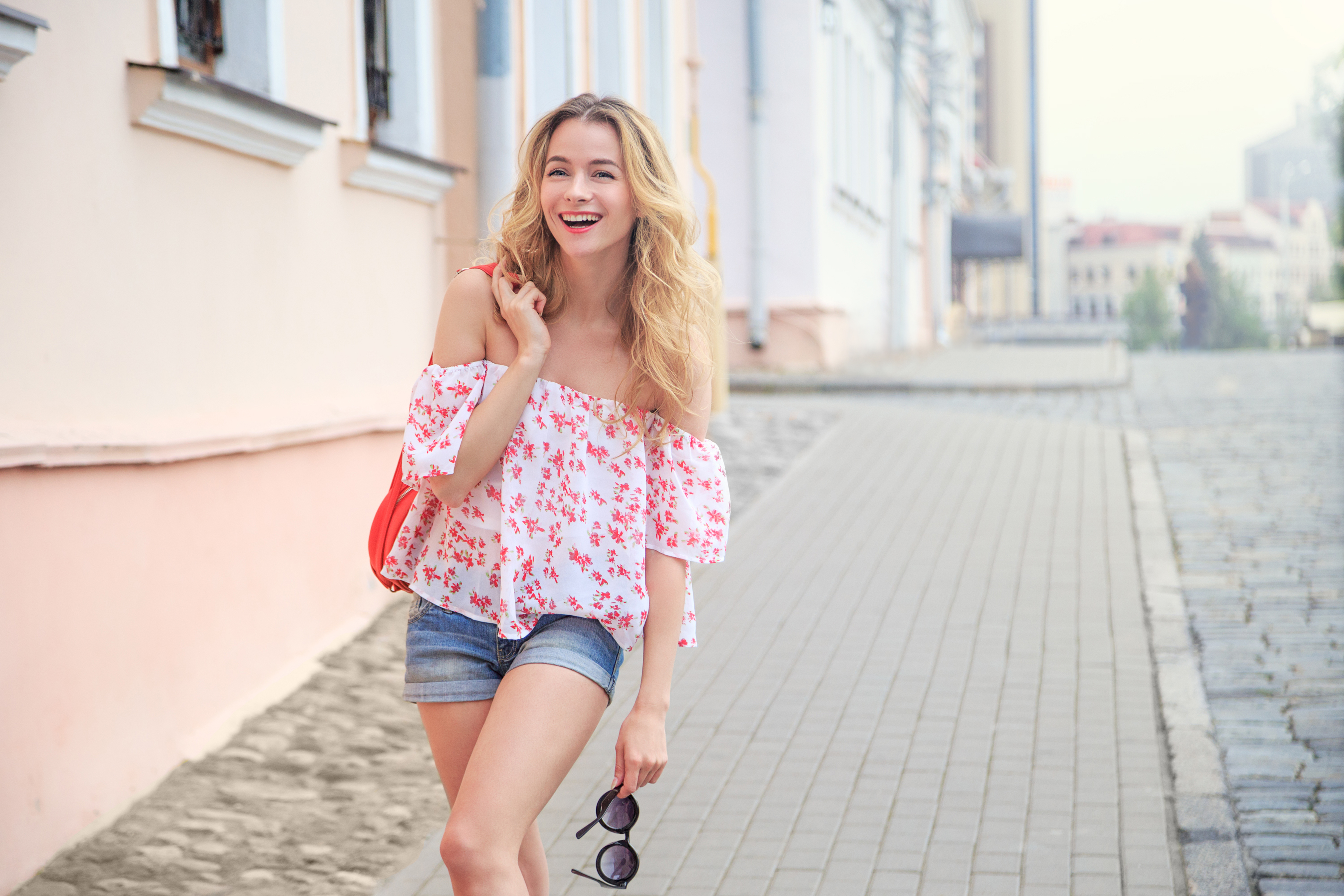 Laughing Fashion Woman in City Street in Europe
