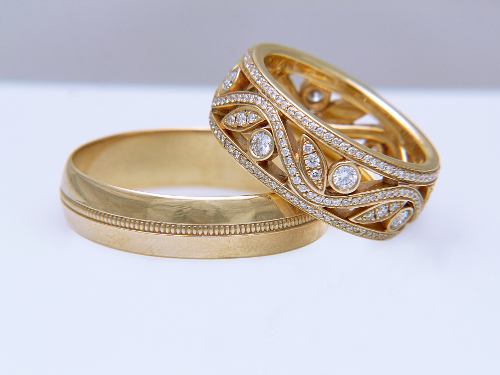Two golden wedding rings on white background